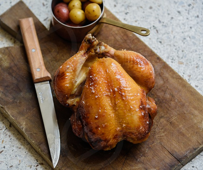 Rotisserie chicken and potatoes photo