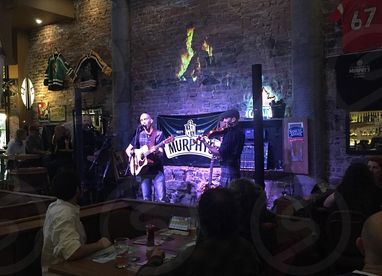 photo of two person singing inside bar photo