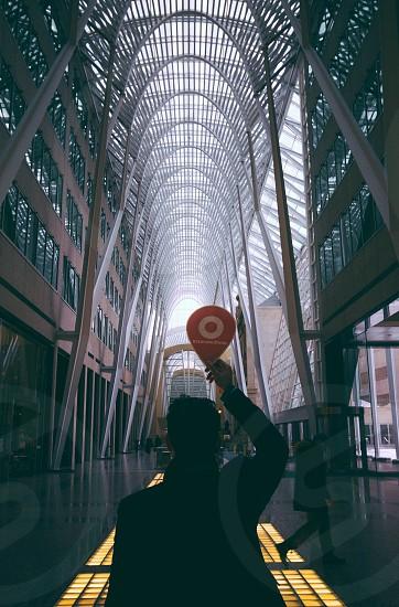 greyscale photography of man holding signage photo
