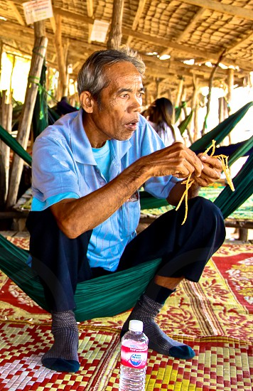 Sitting on the hammock at the side of lake in Cambodia photo
