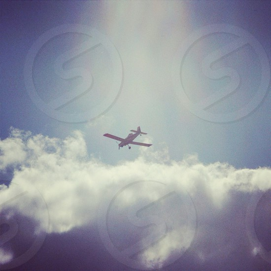 airplane flying into clouds photo