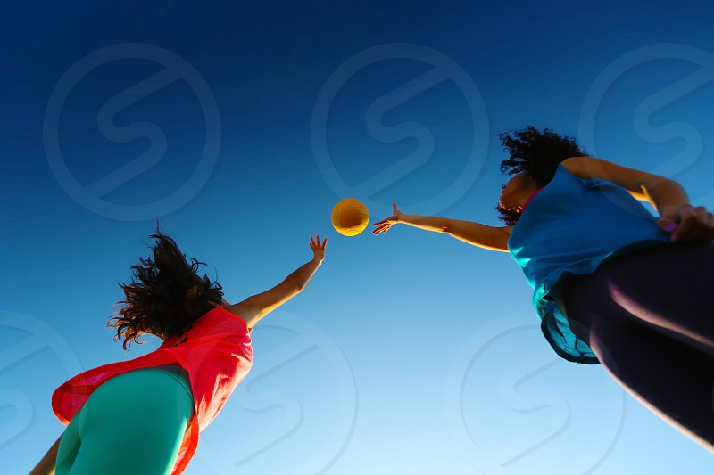 playing ball couple girls friends fitness volley sky blue photo