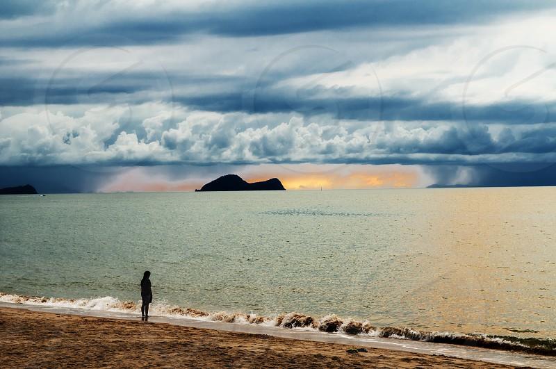 Alone on the beach at dusk photo