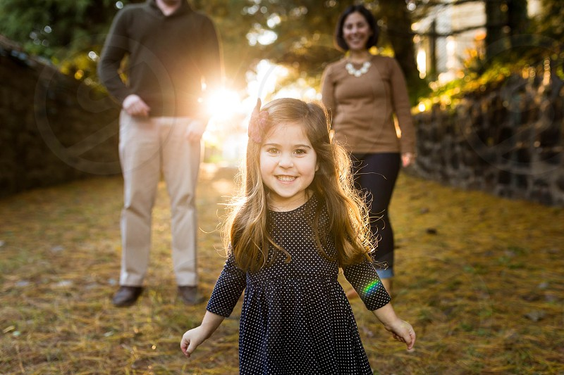 Outdoor fall family photo session with darling little girl. photo