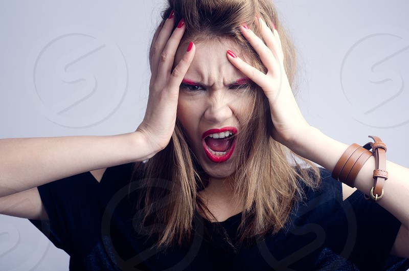 Girl freak out model woman screaming desperate  photo