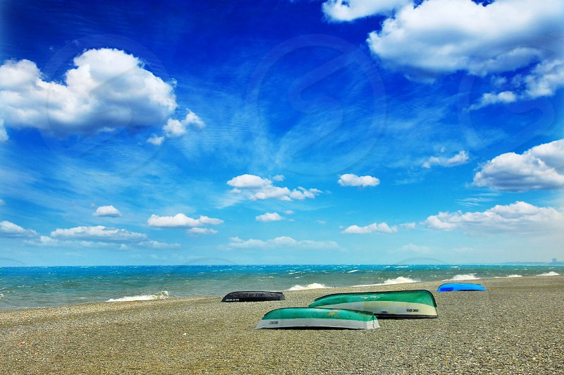 green boats on a beach photo