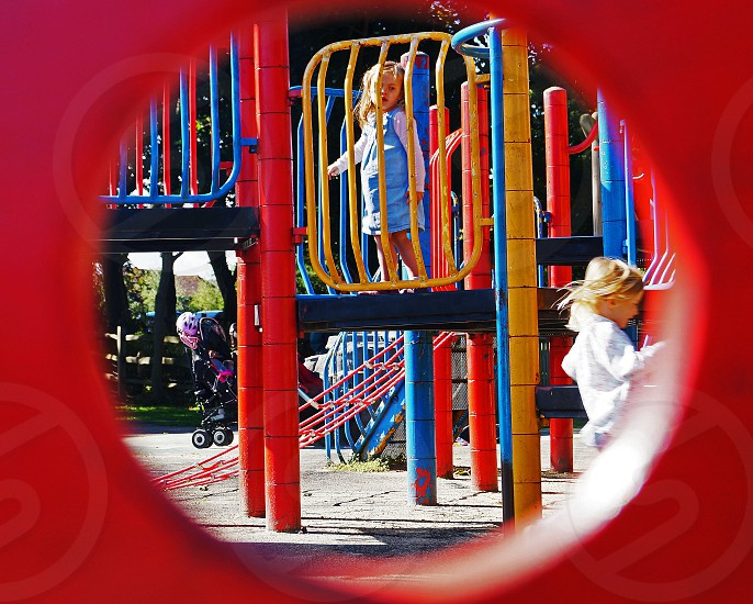 children playing in a park through a different perspective  photo