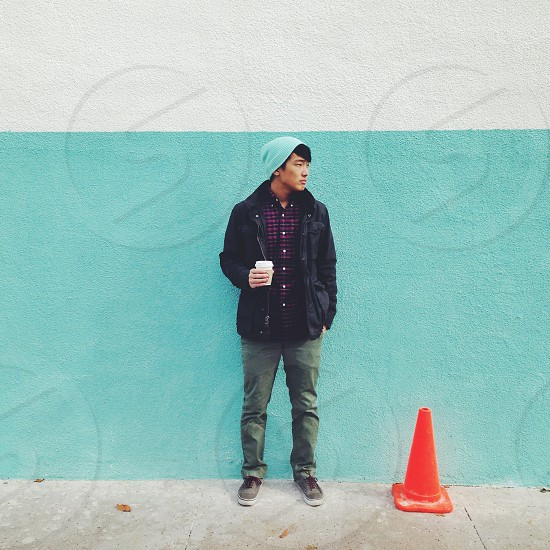 man standing near traffic cone photo