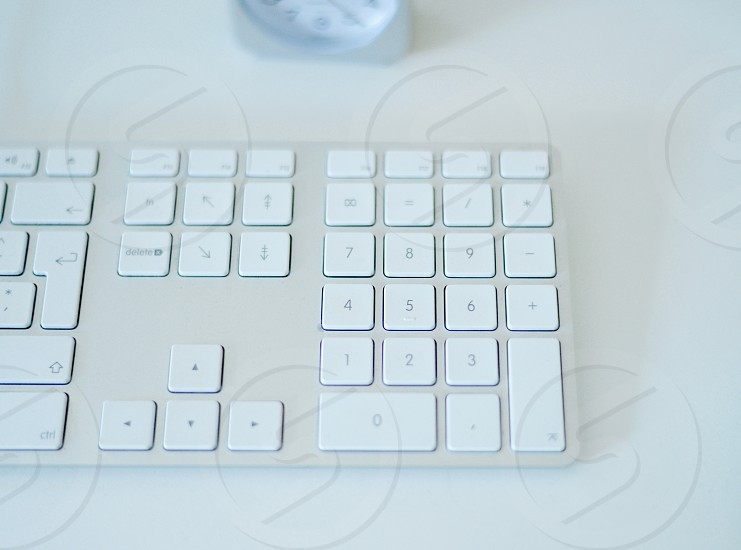 white keyboard on white surface photo