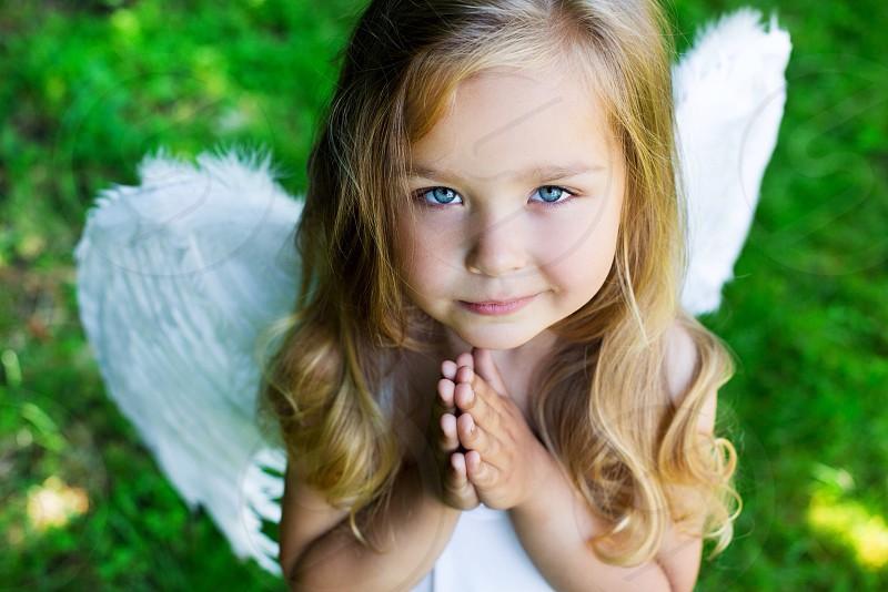 Inspiring reflective meditative pray baby kid angel sweet heart love girl  photo