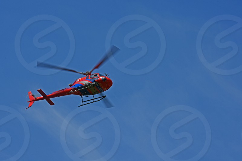 helicopter blue sky photo
