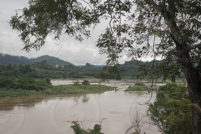 the landscape of the mekong river on the road fron the Town Nong Khai to the town of Chiang Khan in Isan in north east Thailand photo