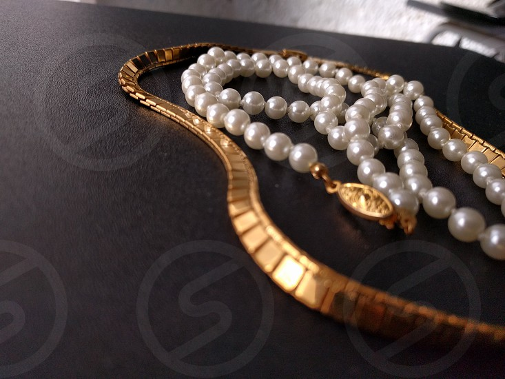 Gold and pearl necklace jewelry photo