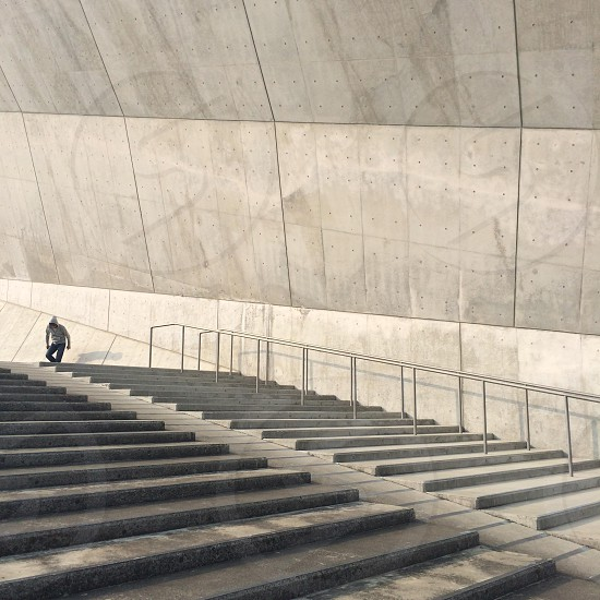 man on the top of stairs photo