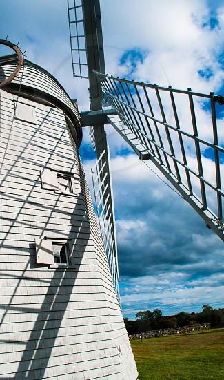 Windmill landscape white sky clouds  photo