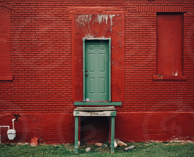 red painted house with the door close photo