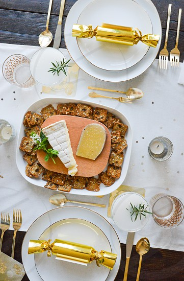 tableware dinner party utensils gold table set dinner food cheese plate cocktails photo