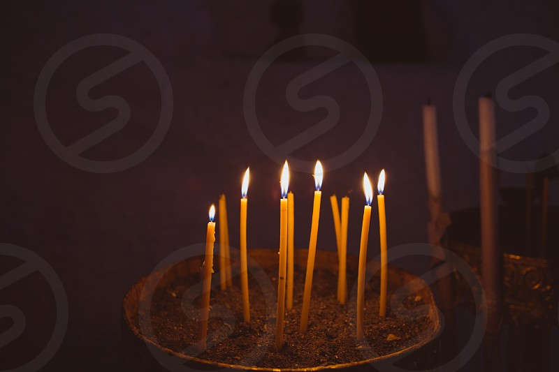 fire candle dark night evening light church religion spirituality spiritual still live  photo