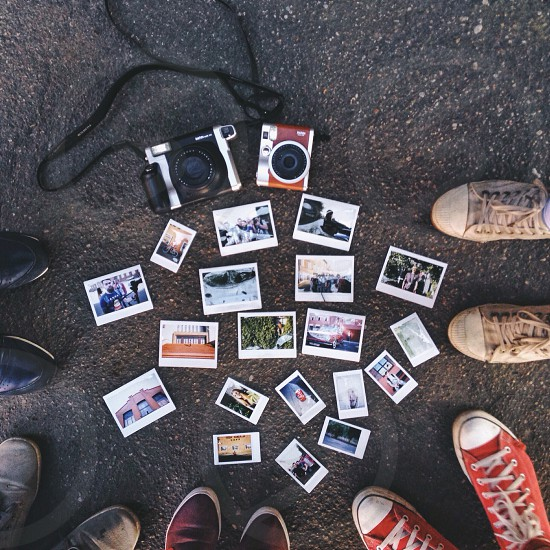 people standing in front of photos on ground photo
