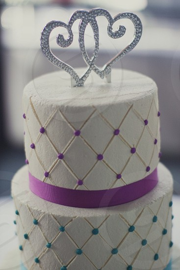 purple and white two layered cake with crown photo