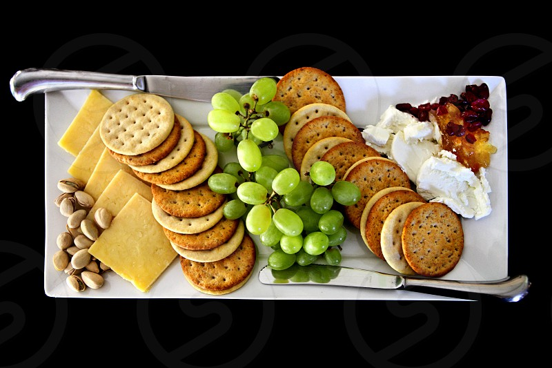 Food culinary dining snacks treats eats appetizers knife plating pistachios crackers cream cheese grapes berries jam jelly healthy photo