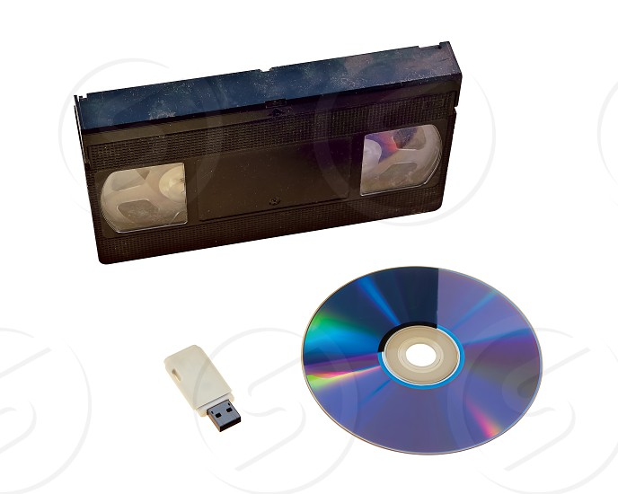Examples of how recording media and technology have changed over time. First came the Video Tape recorder. Then came the DVD recorder. Now videos and music can be stored on little USB Data Drives as MP4 files. What's next? photo