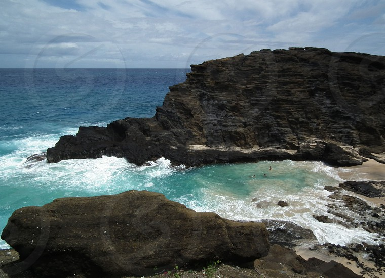 seawater crashing on the rocks photo