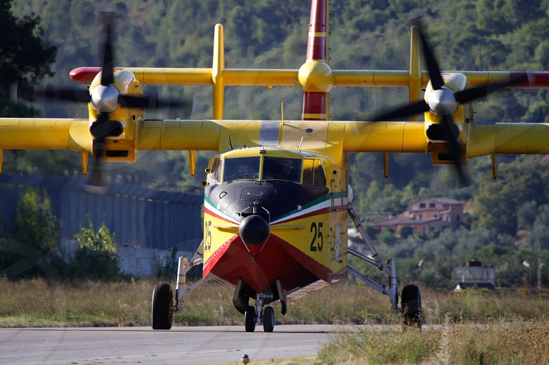 yellow black and red plane photo
