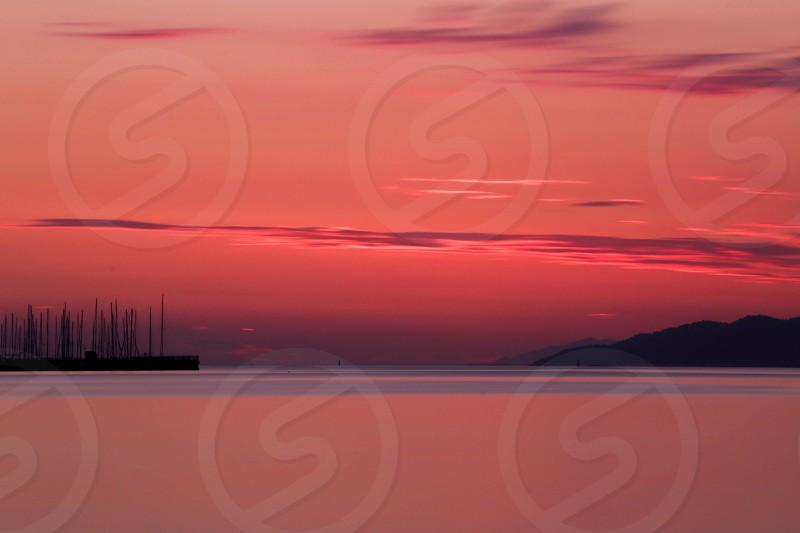 sailboat at sunset photo