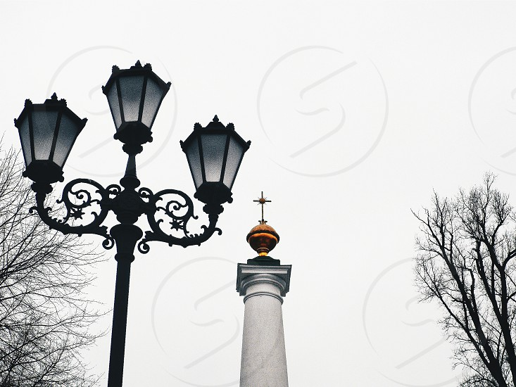 silhouette of street light under cloudy sky photo