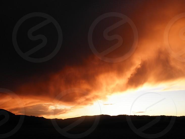 sunset storm sunset storm clouds storm clouds horizon landscapeorange black brown photo