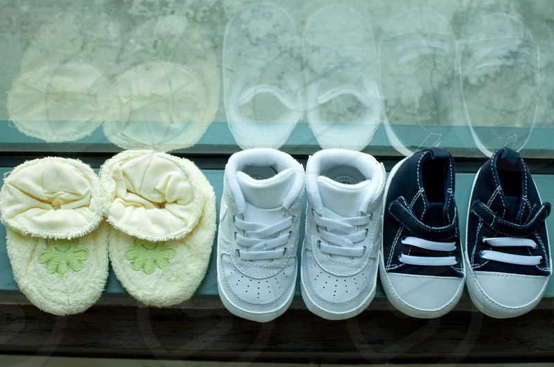 A collection of baby shoes photo