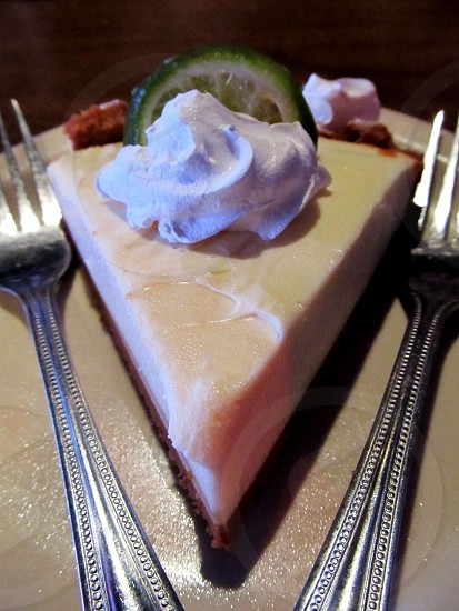 Key lime pie with two forks photo