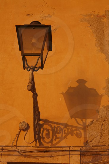 a lamp with shadow in the old Town of Siracusa in Sicily in south Italy in Europe. photo