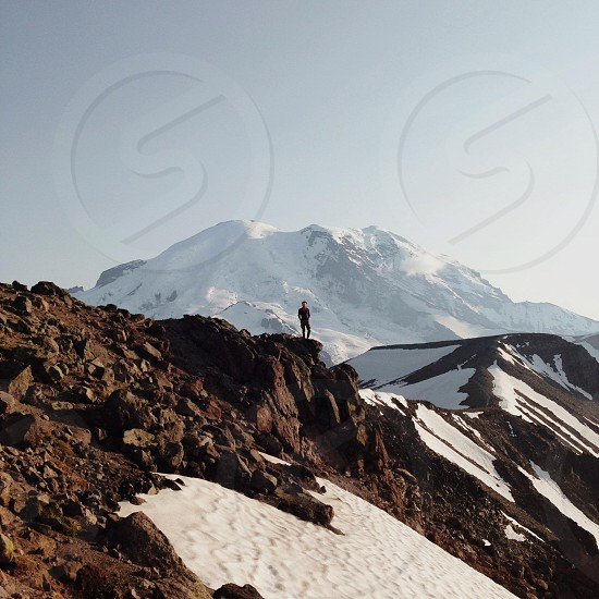 man standing in snowy mountain photo