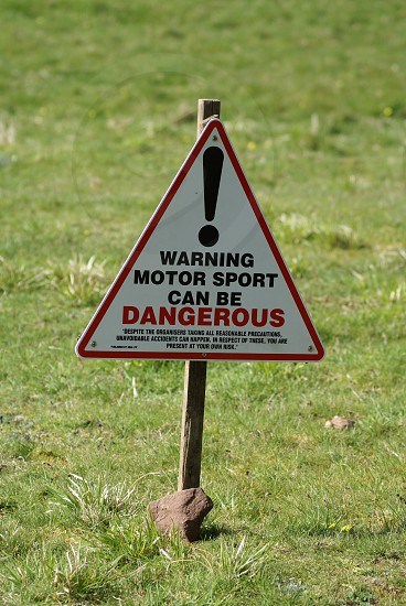 Warning sign Motorsport can be dangerous photo