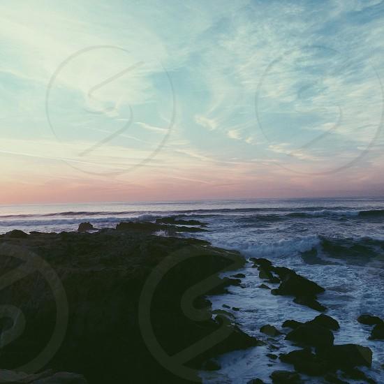 seashore with rocks photography photo