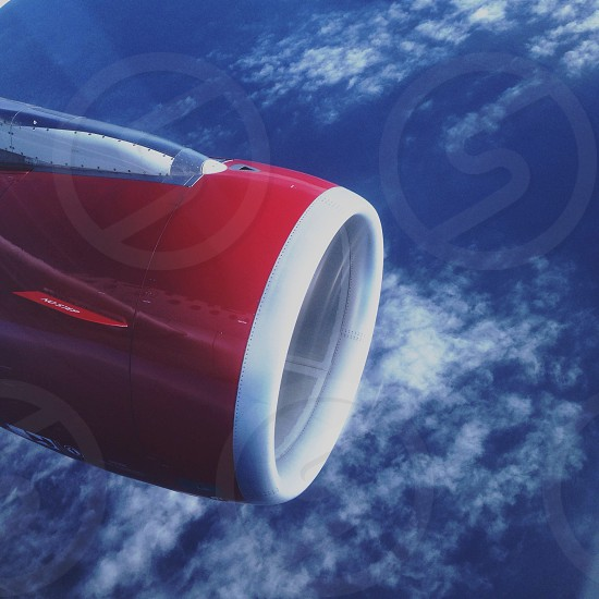 red and white airplane engine photo