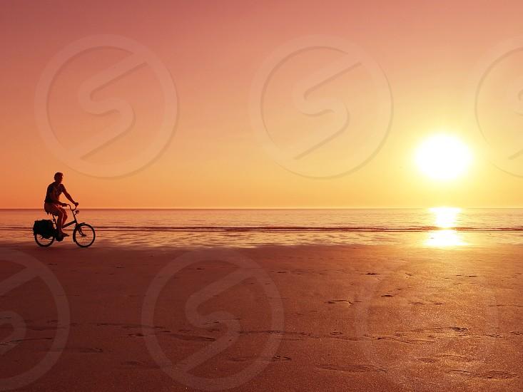 Bicycle beach sunset photo