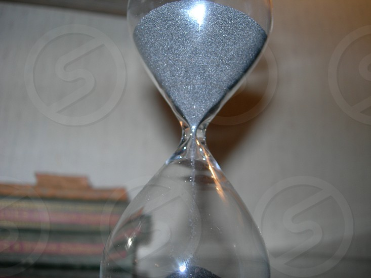 Close up of an hourglass.  photo