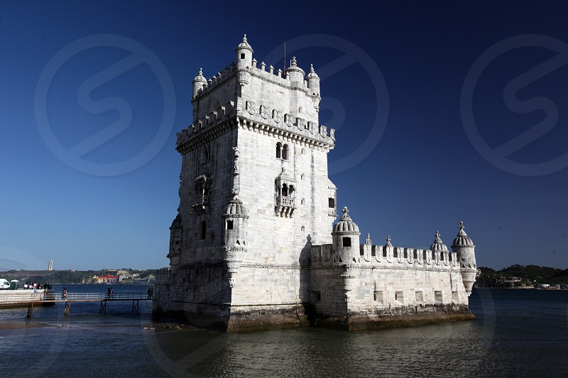 the Torre de Belem in Belem in the city of Lisbon in Portugal in Europe. photo
