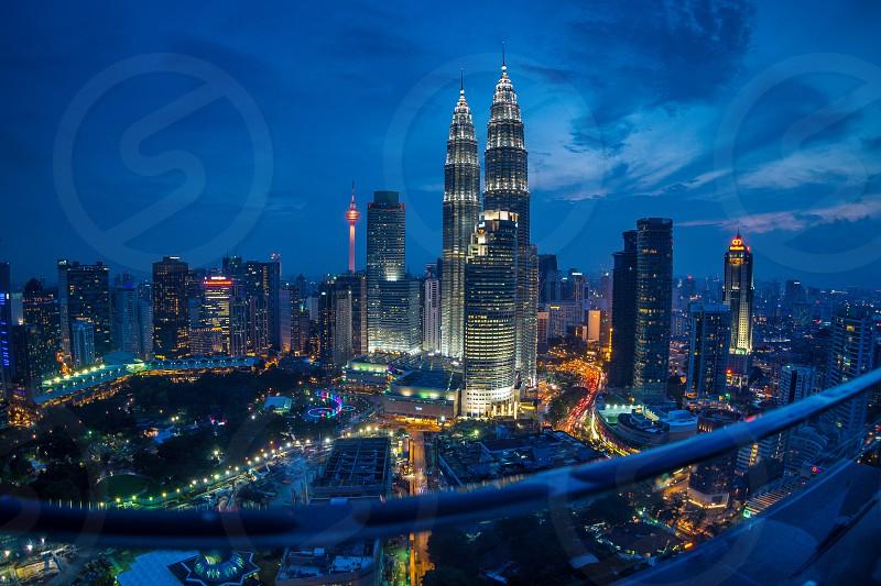 High angle fish eye view of the famous Petronas Twin Tower Kuala Lumpur at blue hour.  photo