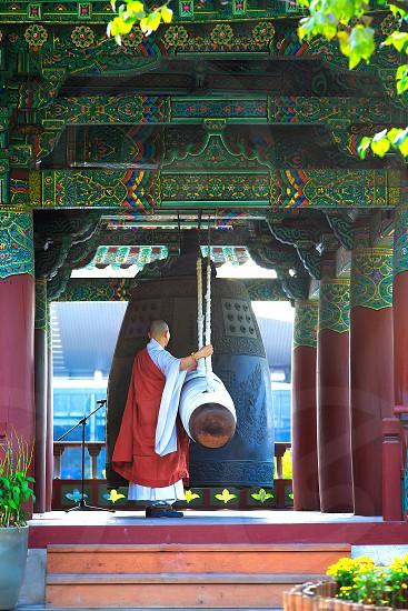 Seoul South Korea October 3 2016 -  korean buddhist mong ring the big bell gong photo