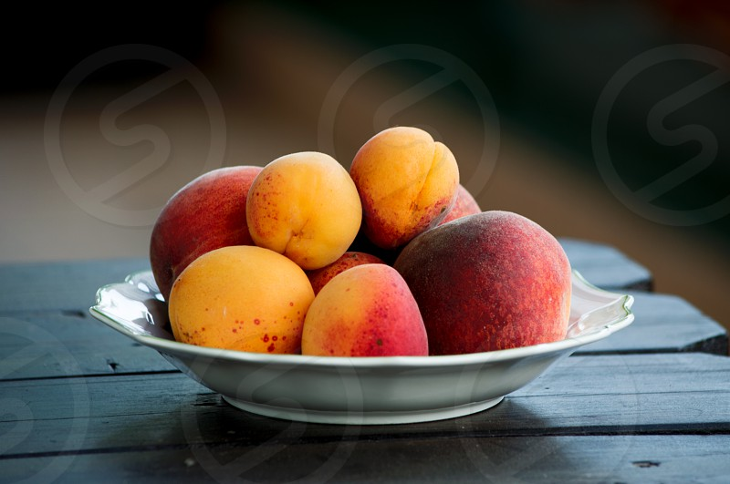 Plate full of fresh and sweet peaches photo