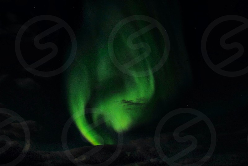 The northern lights are aways a spectacular display. This night in particular they were amazing giving wonderful shapes to photograph and a vivid green color.  photo
