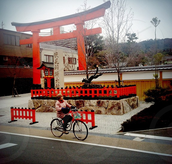 woman riding a bicycle in front photo