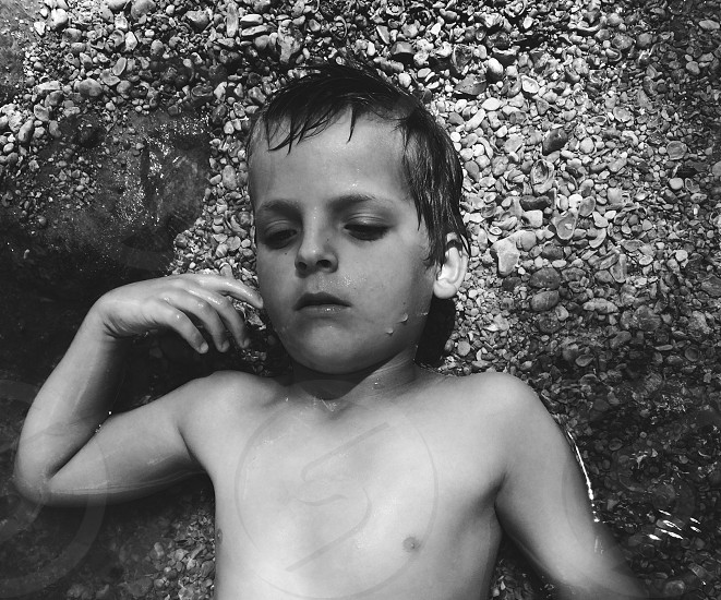 childhood boy water rocks creek america american south central texas texas summer photo