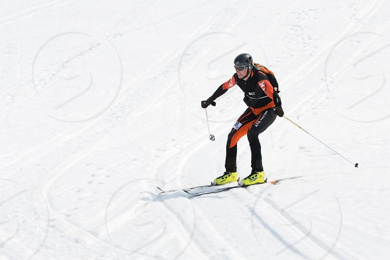 AVACHA KORYAK VOLCANOES KAMCHATKA RUSSIA - APRIL 27 2014: Ski mountaineer rides from Avachinsky Volcano. Team Race ski mountaineering Asian ISMF Russian and Kamchatka Championship. photo