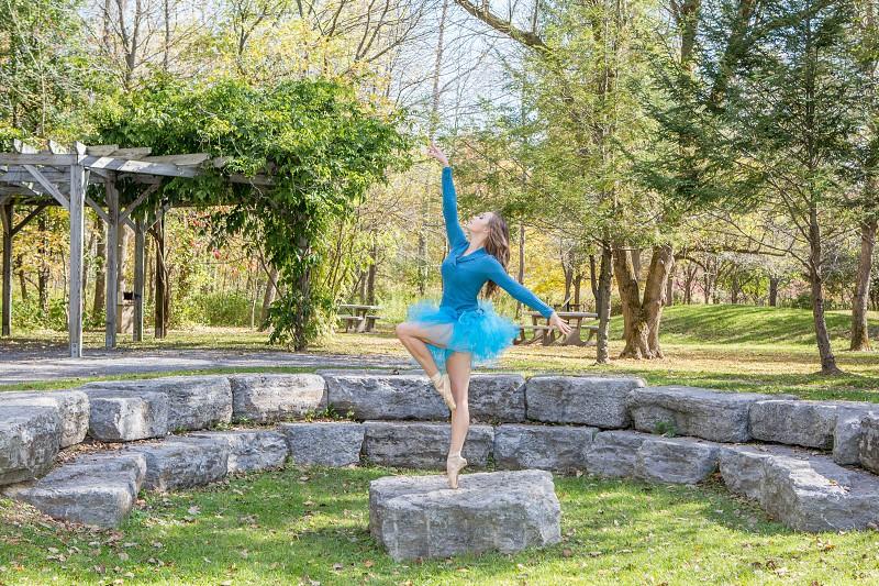 girl dancing in blue tutu outside photo