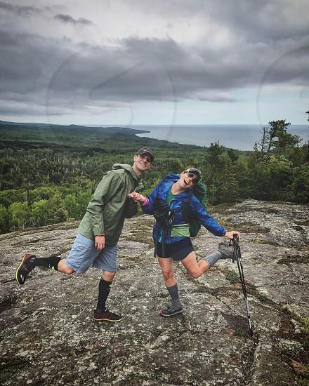 Happy backpackers hiking  photo